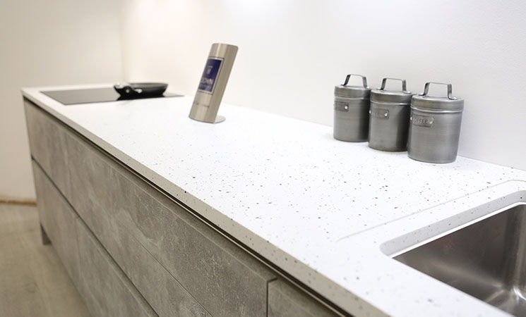 Solid acrylic white kitchen worktop with terrazzo effect
