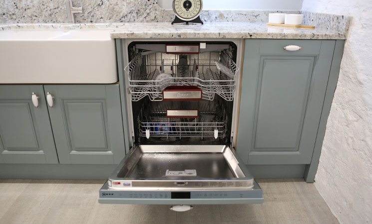 Integrated dishwasher in duck egg blue fitted kitchen