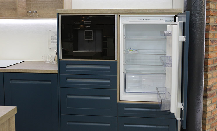 Integrated refrigerator appliance in navy blue fitted kitchen