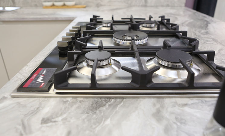Neff gas hob for on grey textured worktop in fitted kitchen
