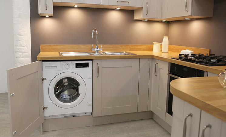 Washing machine integrated appliance in coffee colour fitted kitchen