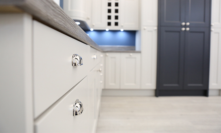 Vintage cup handles on traditional cream fitted kitchen