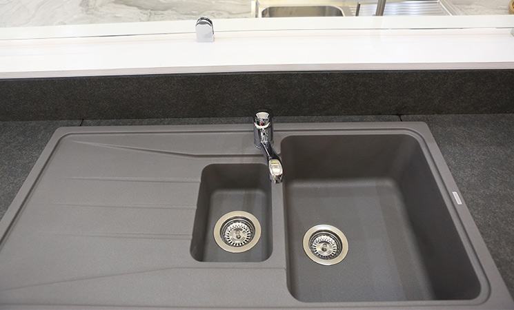 Composite sink with dark grey worktop.