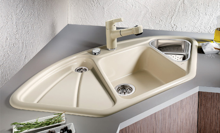 Utilise every area of the kitchen with a corner composite sink