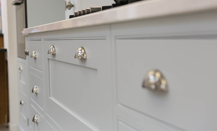 Vintage style cup handles on traditional style baby blue kitchen cabinets