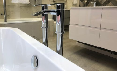 bath filler or deck mixer taps in a bathroom