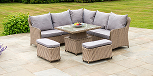 An outdoor sofa set with table and bench seating on a patio