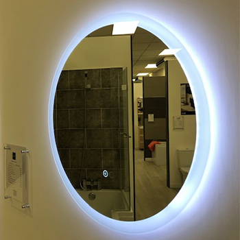 round led bathroom mirror in blue light