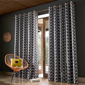 Orla Kiely patterned Charcoal Curtains hanging on a large window