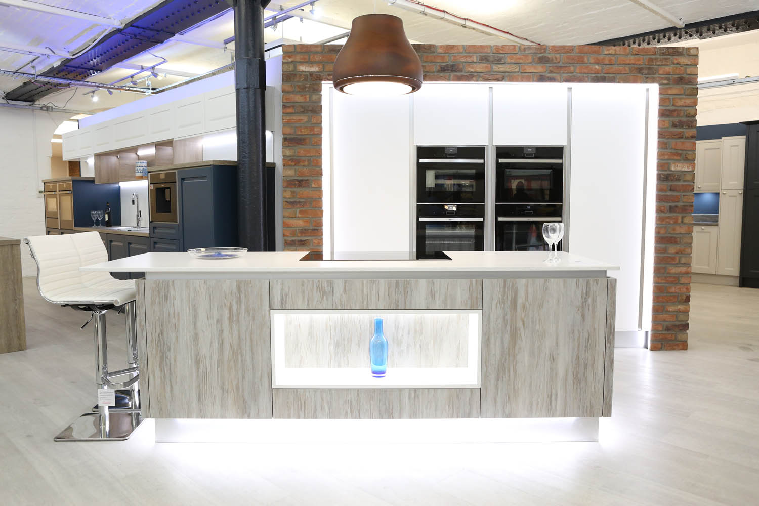 Elica extractor with white and grey textured fitted kitchen cabinets