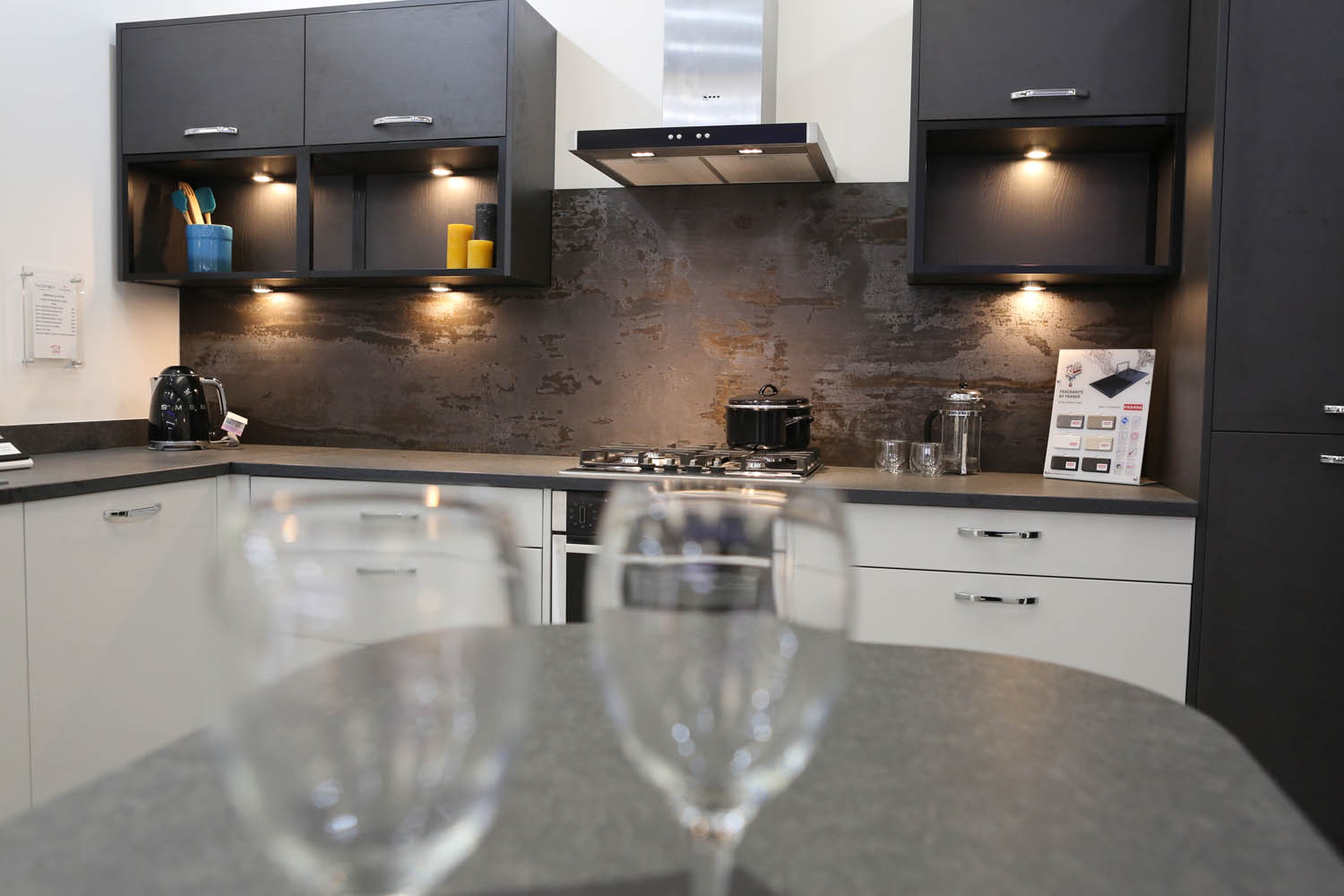 Gardiner Haskins fitted kitchen showroom - dark grey fitted kitchen with a slate patina splashback