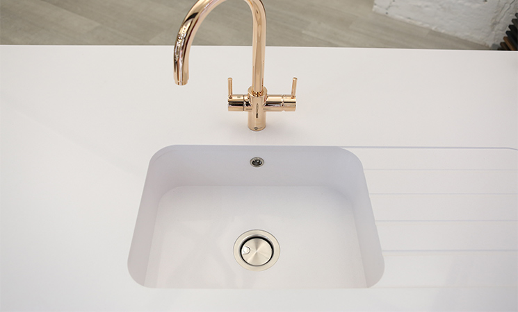 Square white acrylic sink with white worktop