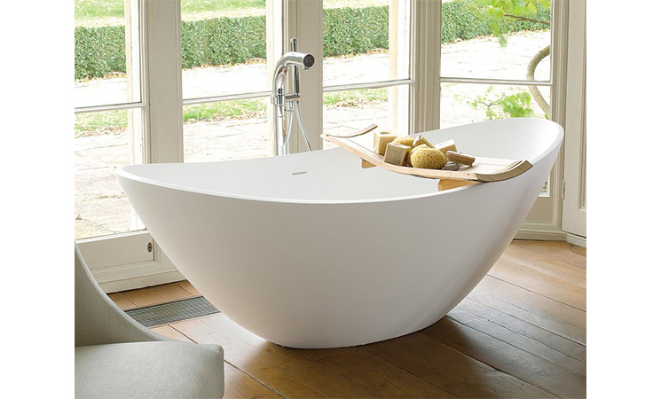 curved white bath tub from waters