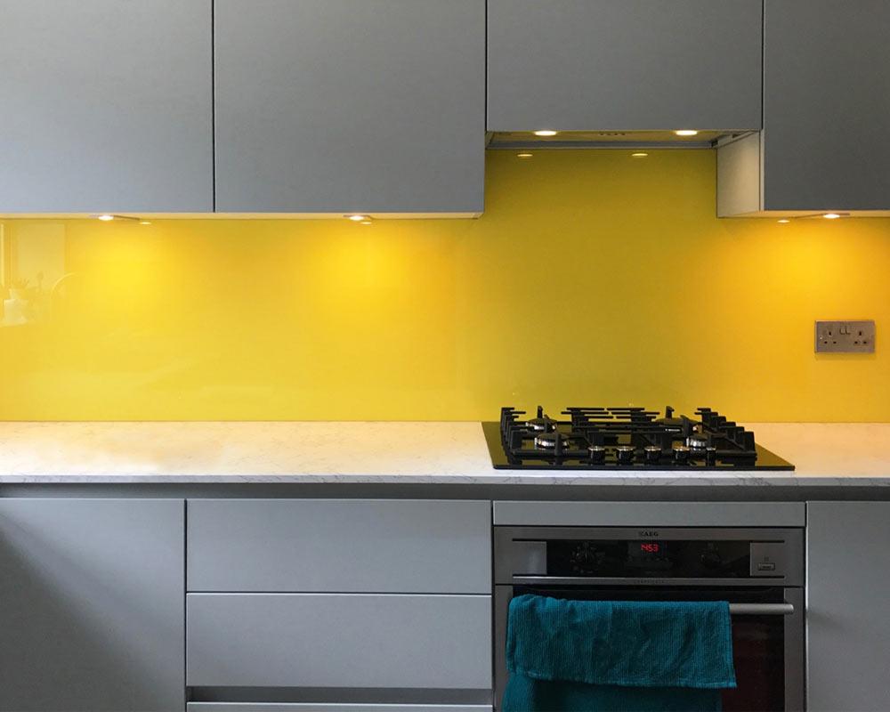 Yellow Splashback In A Grey Kitchen